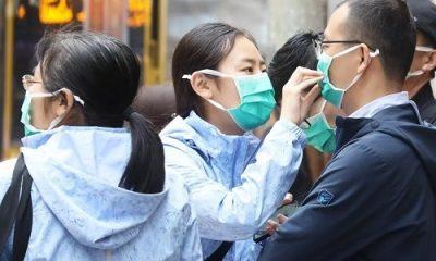 Hàng triệu người Trung Quốc ra đường phải đeo khẩu trang để ngăn sự lây lan của virus corona. Ảnh: SCMP.