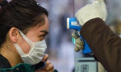 Nhiều người Trung Quốc đã bị ám ảnh bởi máy đo thân nhiệt. Ảnh: SCMP.
